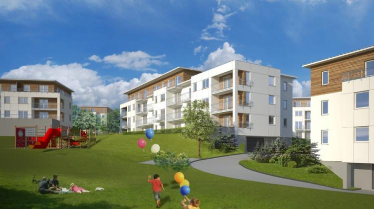 Stonowana kolorystyka elewacji wpisze się w naturalne otoczenie osiedla.