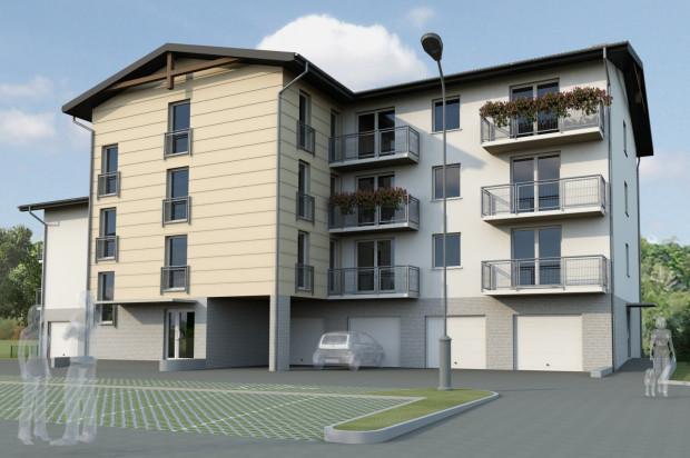 W budynku przewidziano garaże indywidualne oraz naziemne miejsca parkingowe.