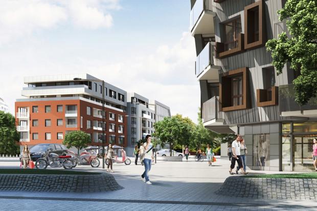 Po prawej budynek Hemara 3, centralnie budynek Hemara 2, znajdujący się po drugiej stronie osiedlowej uliczki.