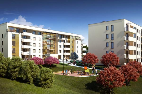 Proste, jasne bryły dwóch budynków otoczone zostaną kwitnącą roślinnością. Obok powstanie plac zabaw dla dzieci.