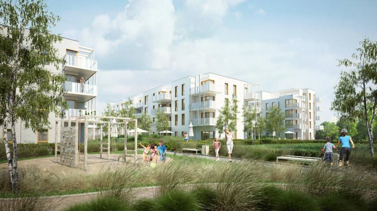 Trzypiętrowe budynki z białymi elewacjami stworzą zamknięte osiedle niedaleko brzeźnieńskiej plaży.