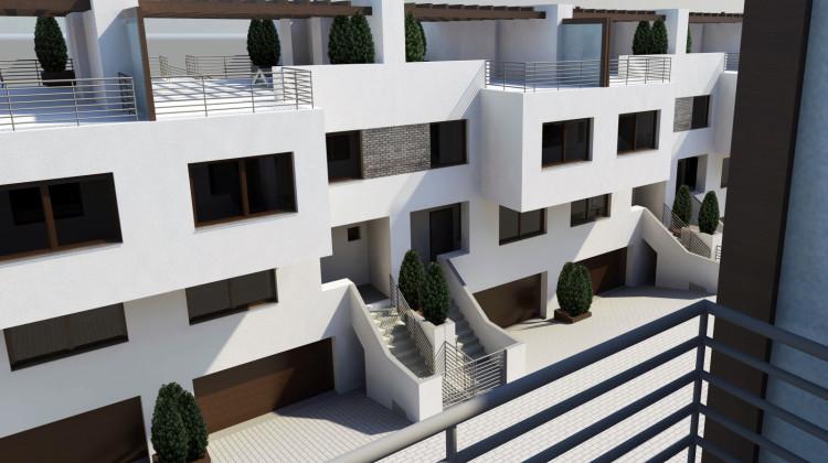 Na dachach domy będą miały obszerne tarasy.
