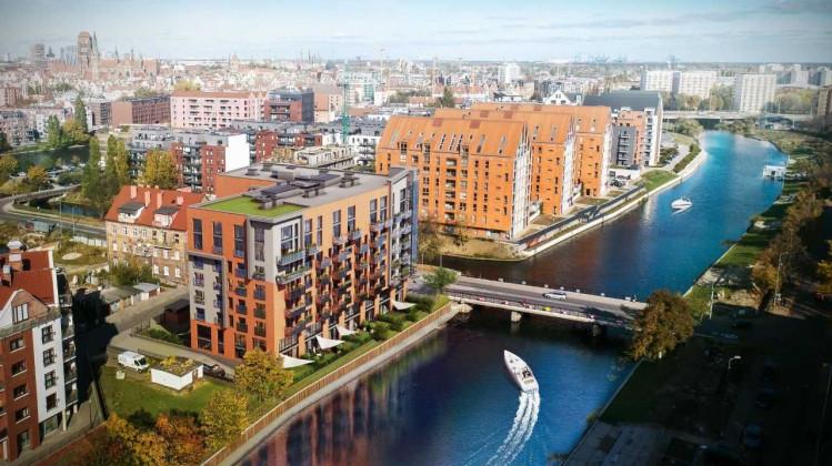 Kolorystycznie i architektonicznie budynek będzie nawiązywał do otaczającej zabudowy.