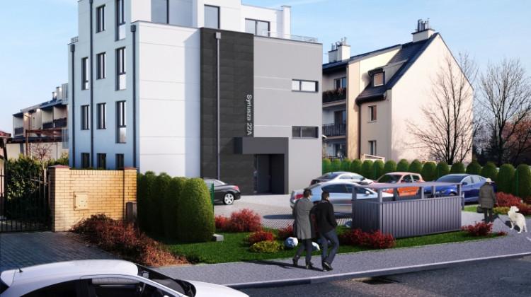 Miejsca parkingowe dla samochodów zaplanowane zostały wokół budynku.