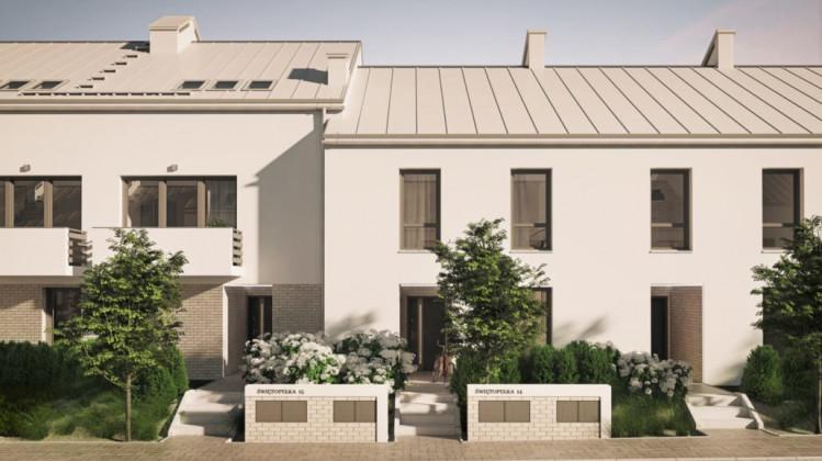 W kameralnej, szeregowej zabudowie kryją się mieszkania jedno-, dwu- lub trzypoziomowe.