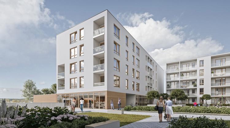 Pięciokondygnacyjne budynki otoczone będą zaprojektowaną zielenią.