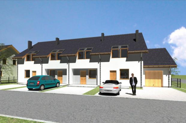 Część domów a osiedlu ma garaże.