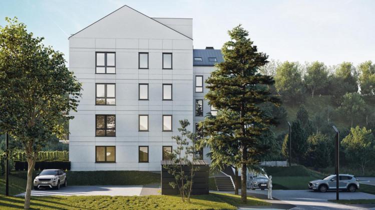 Budynek powstanie w intrygującym miejscu dzielnicy Chełm, będzie otoczony zielenią.