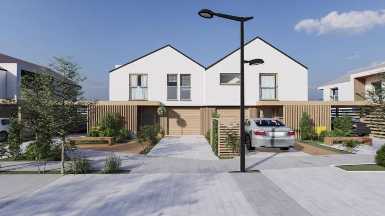 W domach będzie garaż, a dodatkowo zadaszone miejsce postojowe obok budynku.