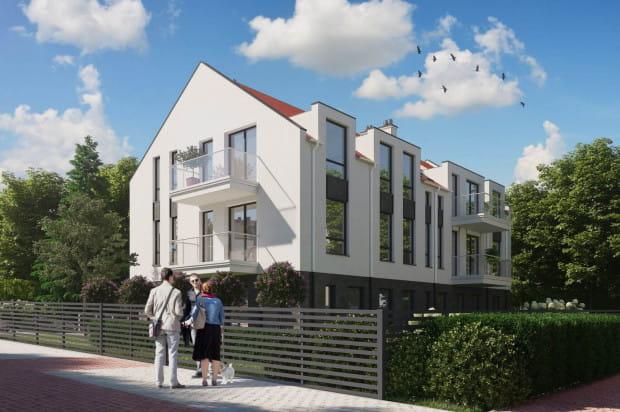 Na dwóch piętrach budynku powstały komfortowe apartamenty, a na parterze lokale usługowe.