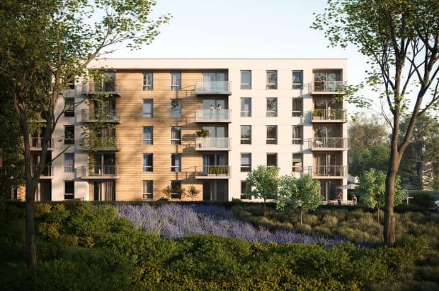 Deskowania na elewacjach budynków pomogą wpisać je w zielone otoczenie osiedla.
