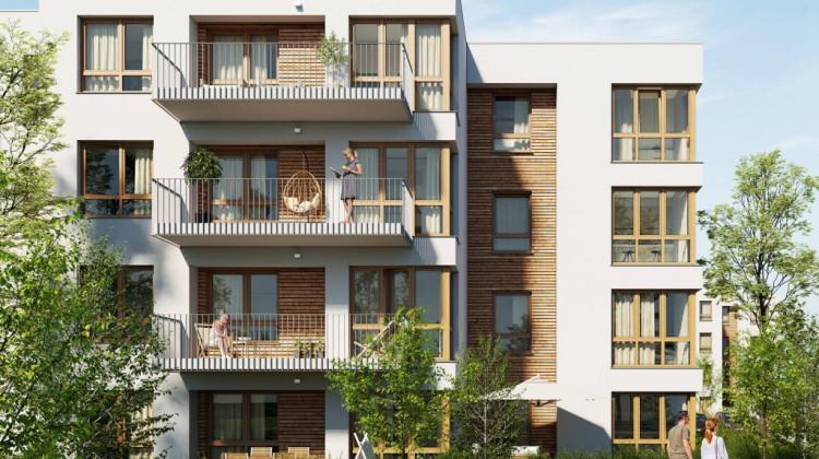 Deskowania na elewacji pomogą wpisać budynki w zielone otoczenie osiedla.