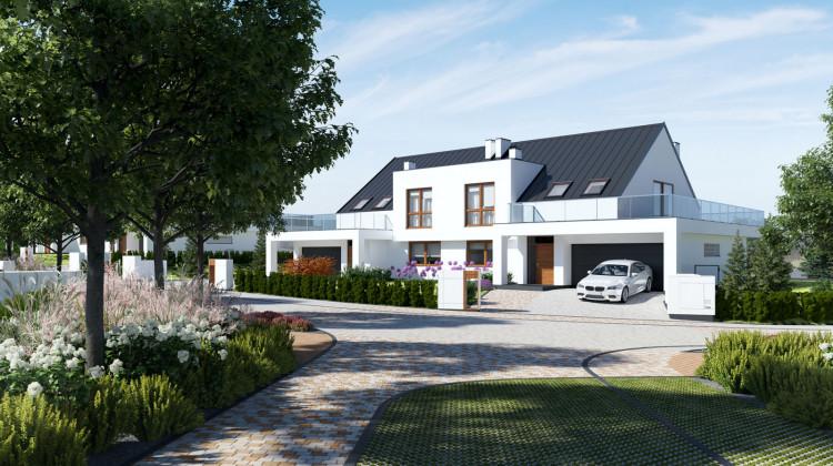 Każdy dom na osiedlu będzie miał obszerny taras na wysokości pierwszego piętra i dwustanowiskowy garaż.