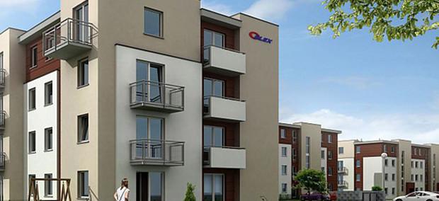 Pomiędzy nowymi budynkami powstają parkingi, chodniki i place zabaw dla dzieci.