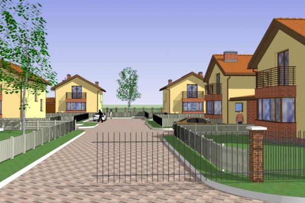 Stonowana kolorystyka elewacji dobrze komponuje się z zielonym otoczeniem kompleksu domów. mat.inwestora