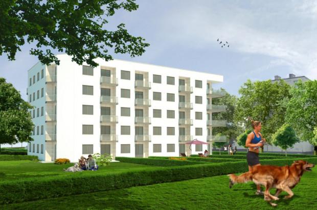 Prosta bryła budynku i jasna elewacja sprawią, że budynek wkomponuje się w istniejącą zabudowę.