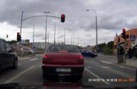 Rowerzysta na czerwonym