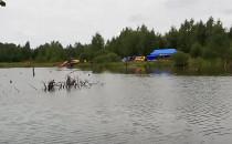 Zbiornik w lesie na Kokoszkach. Duża...