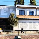 'New Port' na elewacji wyremontowanego budynku w Nowym Porcie