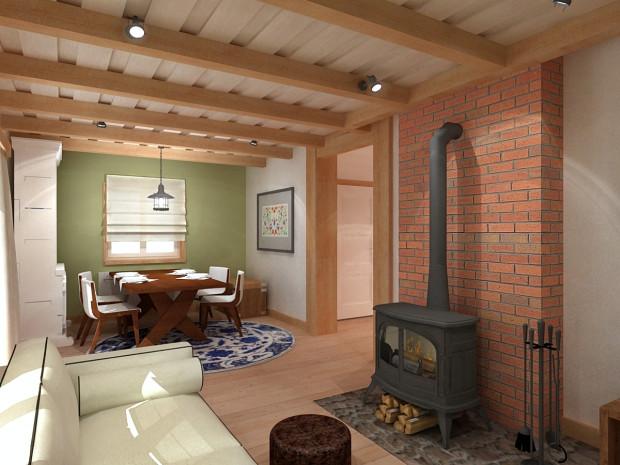 Koncepcja pierwsza. Naturalne materiały wykończeniowe, imitacja drewnianej powały pod sufitem oraz odpowiednio dobrane meble, nawet we współcześnie wybudowanym domu pomogą stworzyć nastrój wiejskiej chaty. Tylko od samych właścicieli zależy jak dalece chcą się takim stylem otoczyć.