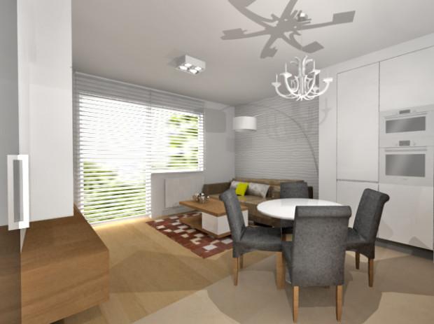 """Umieszczenie we wnętrzu prostej, """"przyściennej"""" zabudowy kuchennej spowodowało, że w centralnym miejscu pomieszczenia zmieści się stół z czterema wygodnymi krzesłami."""