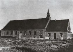 Budynek dawnej pruskiej ujeżdżalni koni, który zaadaptowany został na kościół.