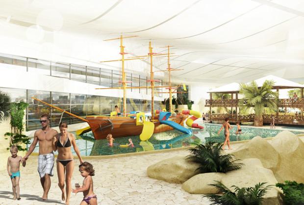 Płytki basen ze zjeżdżalniami dla dzieci.