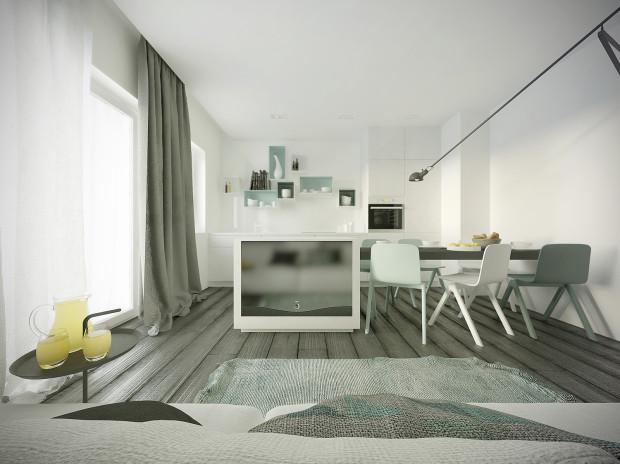 Umieszczenie telewizora na kuchennej wyspie naprzeciwko kanapy pozwoli na komfortowy odbiór obrazu.