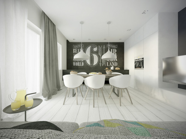 Ściana nad zabudową kuchenną pomalowana farbą tablicową może posłużyć do tworzenia najróżniejszych galerii - w zależności od potrzeb i nastroju domowników.