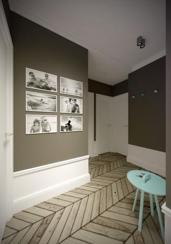 Wyeksponowana na ciemnym tle galeria fotografii tej samej wielkości na pewno chociaż na chwilę przyciągnie uwagę każdego gościa.