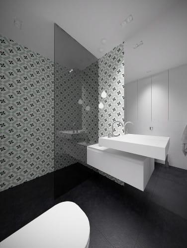 Szeroki prysznic z deszczownicą i odpływem w podłodze powoduje, że korzystanie z niego jest przyjemnością. Jedna, prosta tafla szkła jest także łatwa w utrzymaniu czystości.