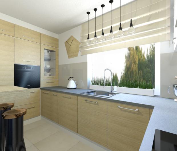 Koncepcja pierwsza. W prostokątnej kuchni wbudować można więcej szafek, dzięki czemu jest tutaj więcej miejsca do przechowywania, a urządzenie tego pomieszczenia jest tańsze.