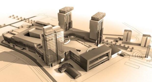 Pierwotna wizja centrum handlowego wraz z trzema wieżowcami. Przed jednym z nich widoczna jest sala BHP.