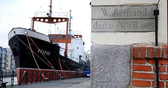 """Tablica upamiętniająca powódź z kwietnia 1829 roku na ścianie spichlerza """"Panna"""" na Ołowiance. W budynku znajduje się obecnie siedziba Centralnego Muzeum Morskiego w Gdańsku."""