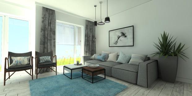 Koncepcja pierwsza. Niebieski dywan przełamuje monotonię wnętrza. Trochę zaskakuje, a przez to ożywia pomieszczenie i podkreśla jego charakter. Jednocześnie jest bardzo funkcjonalny.
