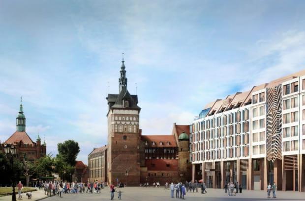 Widok od strony Targu Węglowego. Ażurowy fragment elewacji podkreśla wejście do prowadzącego na przestrzał zabudowy wewnętrznego pasażu.