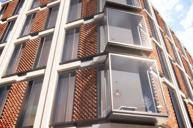 Narożnik widoczny od strony Złotej Bramy. Szklane wykusze mają to atrakcyjny element zarówno dla użytkowników budynku, jak i osób które będą nie patrzeć od strony Złotej Bramy.