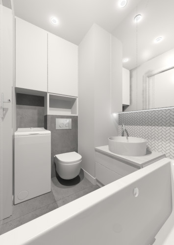 Po lewej stronie pomieszczenia umieszczona została misa WC, pralka oraz przestrzeń do przechowywania.