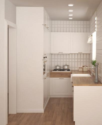 Niewielka przestrzeń kuchni została zachowana w klasycznej stylistyce. We wnętrzu przeważa biel, drewno oraz materiały drewnopodobne.