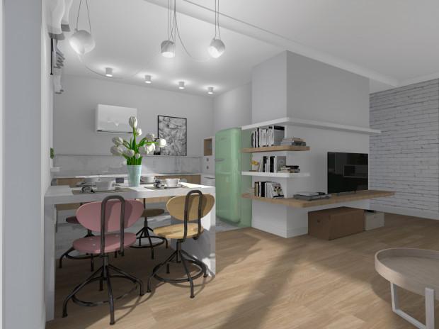 Przestrzeń kuchni została optycznie wydzielona. Zaplanowane sprzęty AGD zostały umieszczone w taki sposób, by nie utrudniać codziennego funkcjonowania właścicielce mieszkania.