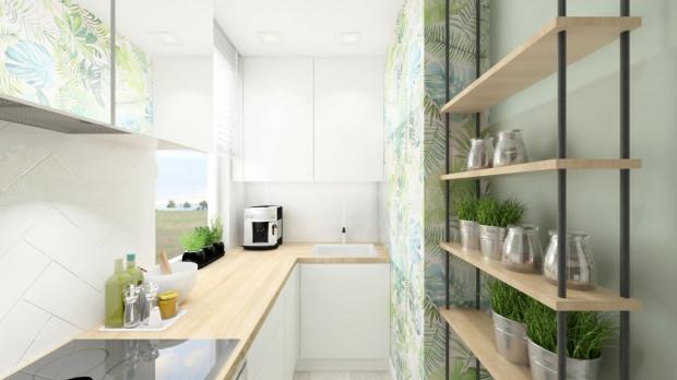 Koncepcja druga. Blat w kolorze drewna powoduje, że niewielkie wnętrze staje się ciepłe, domowe.