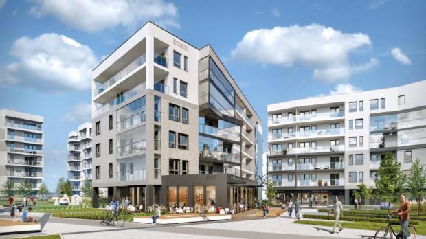 """Lokale użytkowe powstają na parterach budynków nowych osiedli. Dzięki temu powstają nowe ruchliwe ulice osiedlowe i """"żyjące"""" przestrzenie wspólne. Na wizualizacji osiedle Idea dewelopera Euro Styl przy ul. Beniowskiego."""