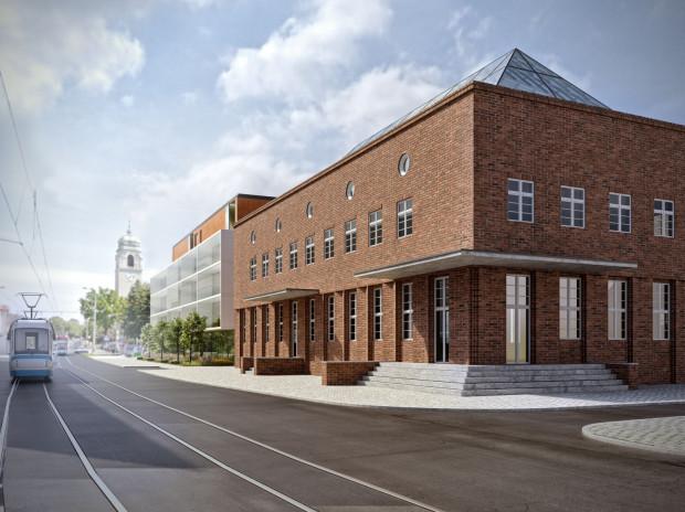 Na pierwszym planie odrestaurowany budynek poczty, a obok niego część nowej zabudowy.