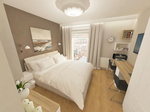 Przestrzeń do pracy wydzielona w sypialni to jedno z częściej wybieranych rozwiązań w kompaktowych mieszkaniach.