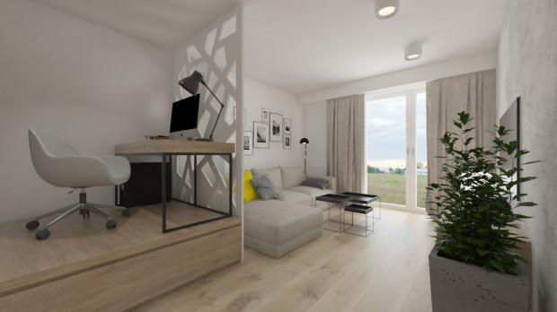 Nawet w małym, wielofunkcyjnym pomieszczeniu miejsce do pracy można (i trzeba) wydzielić. W tym przypadku w podeście znajduje się materac do spania.