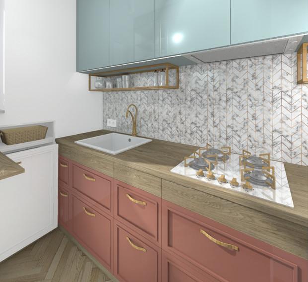 Koncepcja pierwsza. Drewniane części zabudowy meblowej  świetnie współgrają ze złotymi dodatkami.