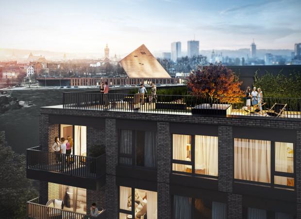 Chlebova. Śródmieście Gdańska. Projektant i inwestor zdecydowali się urządzić na dachu przestrzeń wspólną dla mieszkańców ze względu na warte oglądania otoczenie budynku.