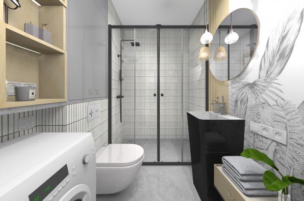 Pierwsza koncepcja zakłada jasną kolorystykę pomieszczenia wzbogaconą o czarne i drewniane akcenty.