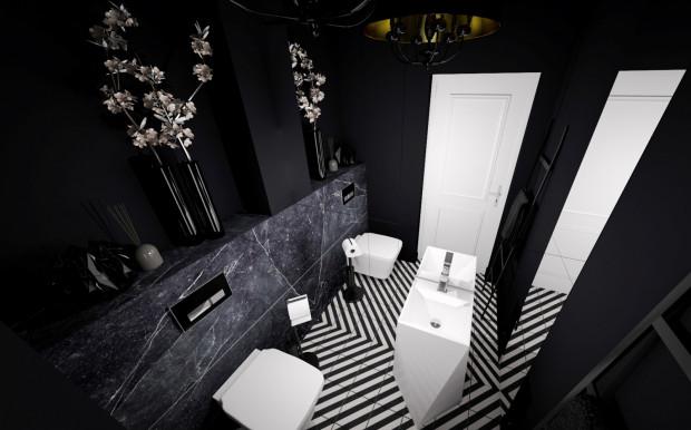 Miłośnicy odważniejszych zestawień ucieszą się, że w łazienkach królują aktualnie czernie z domieszką bieli lub szarości.