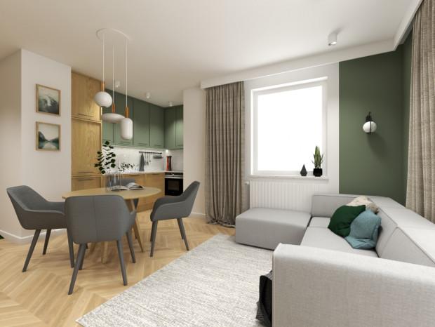 """Koncepcja pierwsza. Kuchnia w kształcie litery """"L"""", z zachowaną właściwą kolejnością urządzeń, zapewnia codzienną wygodę korzystania z tej części mieszkania."""